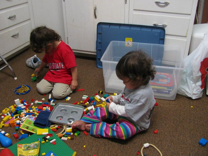 My nieces raiding Grandma's toy cabinet in October 2010